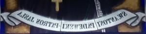 Witrażowy napis pod św. Antonim