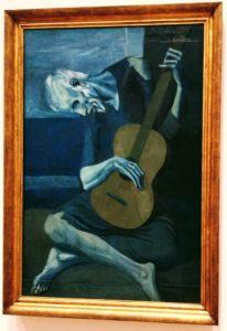 """Tak Picasso widzi gitarzystę, który zbyt dużo chałturzył po weselach ;) (""""Old man guitarist"""")."""